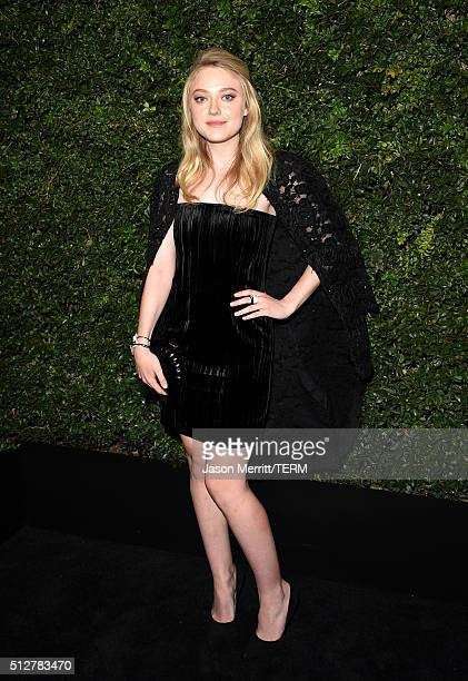 Actress Dakota Fanning attends the Charles Finch and Chanel PreOscar Awards Dinner at Madeo Restaurant on February 27 2016 in Los Angeles California