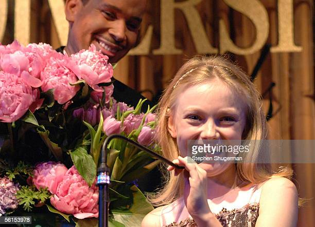 Actress Dakota Fanning receives flowers from actor Robert De Niro before receiving the Female 'Nova Award' for young artist on the rise from...