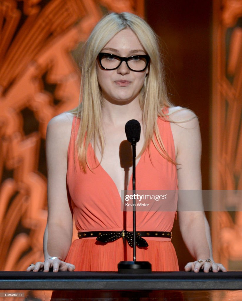 Actress Dakota Fanning speaks onstage at the 40th AFI Life Achievement Award honoring Shirley MacLaine held at Sony Pictures Studios on June 7, 2012 in Culver City, California. The AFI Life Achievement Award tribute to Shirley MacLaine will premiere on TV Land on Saturday, June 24 at 9PM