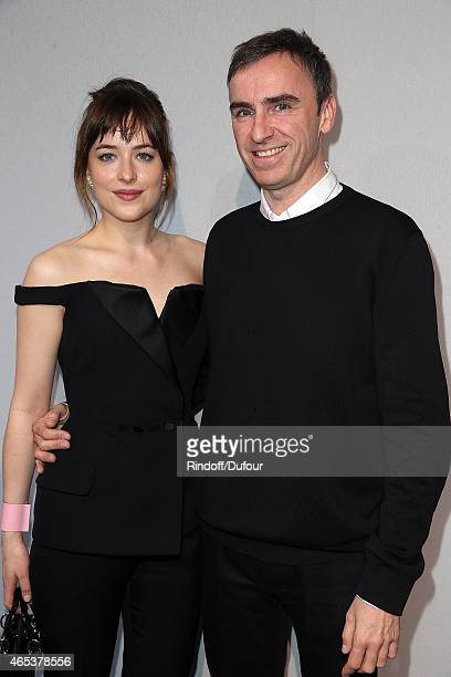 Actress Dakota Johnson and Designer Raf Simons pose after the Christian Dior show as part of the Paris Fashion Week Womenswear Fall/Winter 2015/2016...