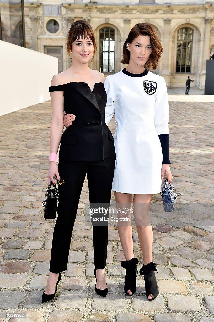 Actress Dakota Johnson and Hanneli Mustaparta attend the Christian Dior show as part of the Paris Fashion Week Womenswear Fall/Winter 2015/2016 on...