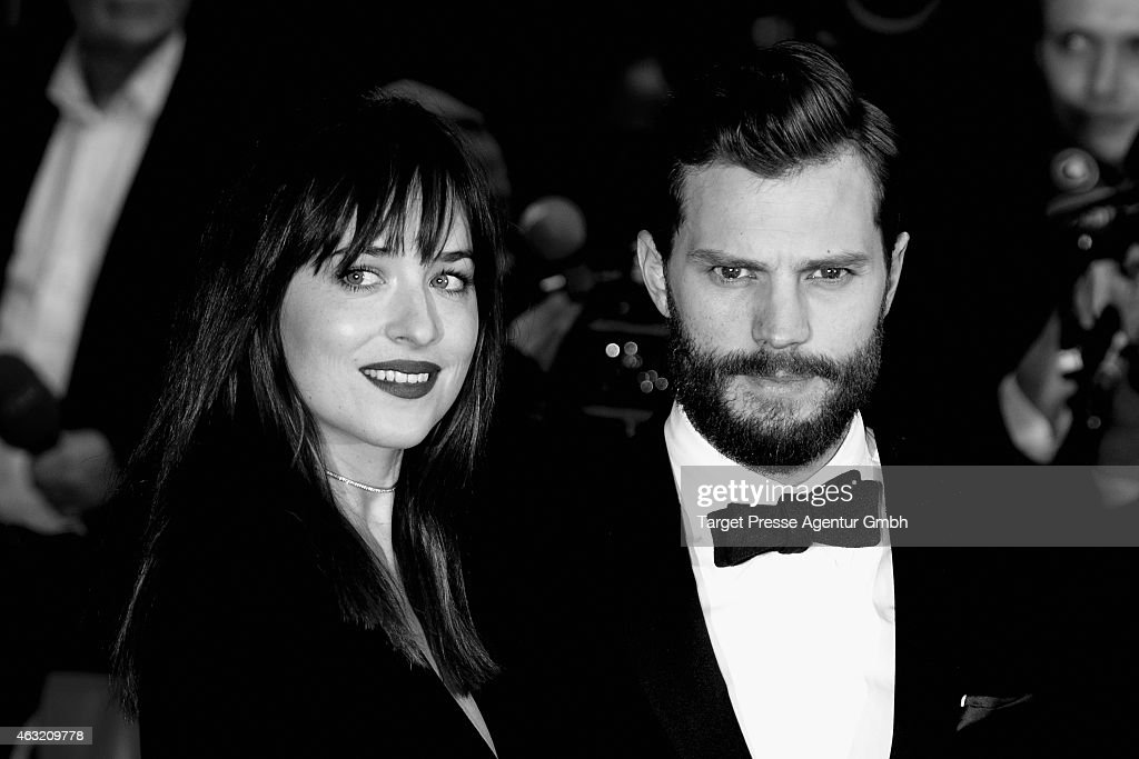 Actress Dakota Johnson and Jamie Dornan attend the 'Fifty Shades of Grey' premiere during the 65th Berlinale International Film Festival at Zoo Palast on February 11, 2015 in Berlin, Germany.
