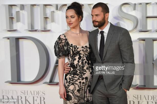 US actress Dakota Johnson and Northern Irish actor Jamie Dornan pose on the red carpet upon arrival at the UK premiere of Fifty Shades Darker in...