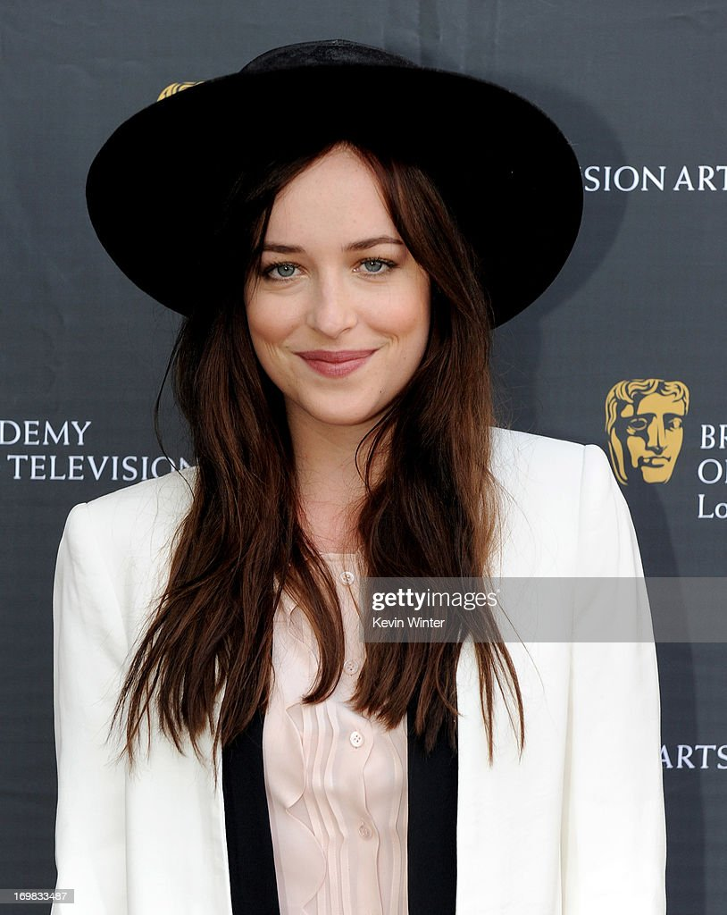 Actress <a gi-track='captionPersonalityLinkClicked' href=/galleries/search?phrase=Dakota+Johnson&family=editorial&specificpeople=2091563 ng-click='$event.stopPropagation()'>Dakota Johnson</a> arrives at the 26th Annual BAFTA LA Garden Party at the British Consul-General's official residence on June 2, 2013 in Los Angeles, California.