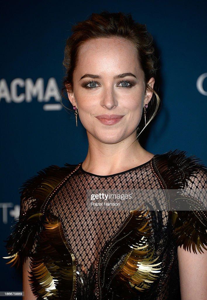 Actress Dakota Johnson arrives at the LACMA 2013 Art + Film Gala on November 2, 2013 in Los Angeles, California.