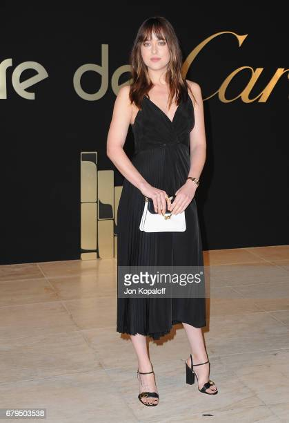 Actress Dakota Johnson arrives at the Panthere De Cartier Party In LA at Milk Studios on May 5 2017 in Los Angeles California