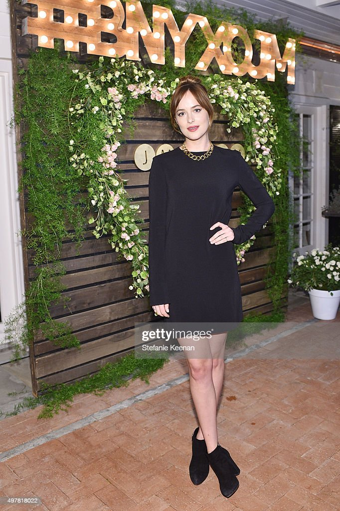 Actress Dakota Johnson attends Barneys New York Jennifer Aniston and Tobey Maguire host a private dinner to celebrate The Barneys New York XO...