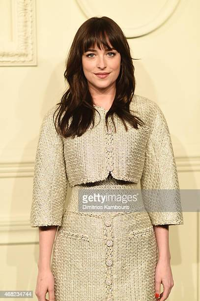 Actress Dakota Johnson attends the CHANEL ParisSalzburg 2014/15 Metiers d'Art Collection at Park Avenue Armory on March 31 2015 in New York City