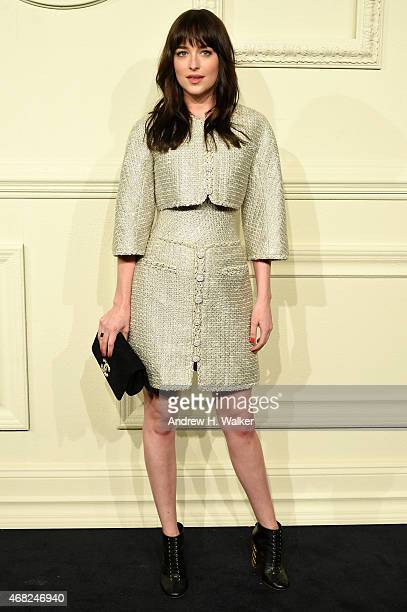 Actress Dakota Johnson attends the CHANEL ParisSalzburg 2014/15 Metiers d'Art Collection in New York City at the Park Avenue Armory on March 31 2015...