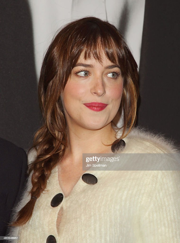 Actress Dakota Johnson attends the 'Fifty Shades Of Grey' New York fan first screening at Ziegfeld Theatre on February 6 2015 in New York City