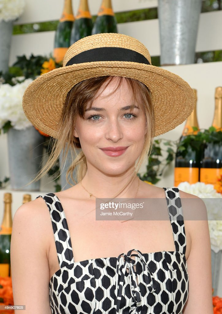 Actress Dakota Johnson attends the seventh annual Veuve Clicquot Polo Classic in Liberty State Park on May 31, 2014 in Jersey City City.