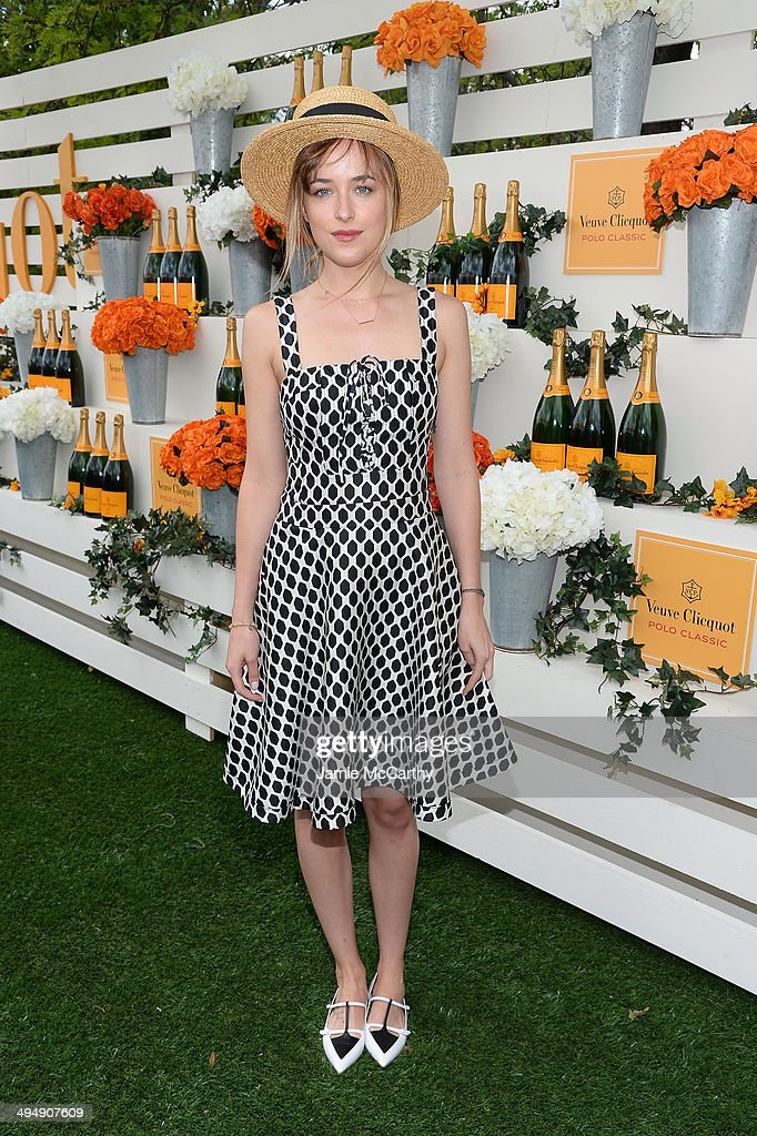 Actress <a gi-track='captionPersonalityLinkClicked' href=/galleries/search?phrase=Dakota+Johnson&family=editorial&specificpeople=2091563 ng-click='$event.stopPropagation()'>Dakota Johnson</a> attends the seventh annual Veuve Clicquot Polo Classic in Liberty State Park on May 31, 2014 in Jersey City City.