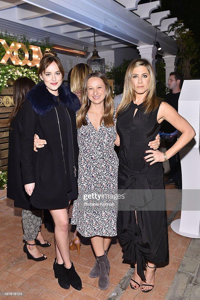 Actress Dakota Johnson designer Jennifer Meyer and actress Jennifer Aniston attend Barneys New York Jennifer Aniston and Tobey Maguire host a private...