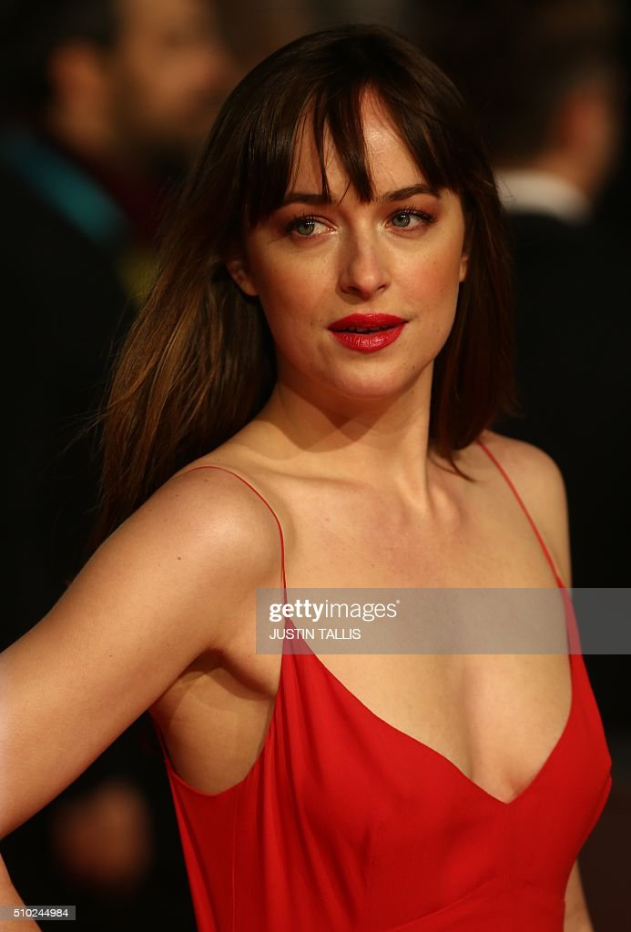 US actress Dakota Johnson poses on arrival for the BAFTA British Academy Film Awards at the Royal Opera House in London on February 14, 2016. TALLIS