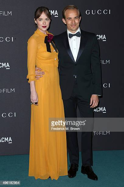 Actress Dakota Johnson wearing Gucci and Jesse Johnson attend LACMA 2015 ArtFilm Gala Honoring James Turrell and Alejandro G Iñárritu Presented by...