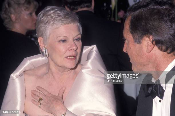 Actress Dame Judi Dench and playwright David Hare attend the 53rd Annual Tony Awards After Party on June 6 1999 at the Marriott Marquis Hotel in New...