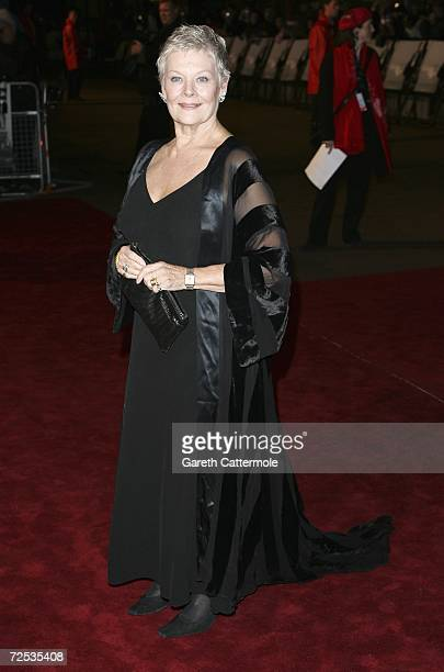 Actress Dame Judi Dench attends the Royal Premiere for the 21st James Bond film 'Casino Royale' at the Odeon Leicester Square on November 14 2006 in...