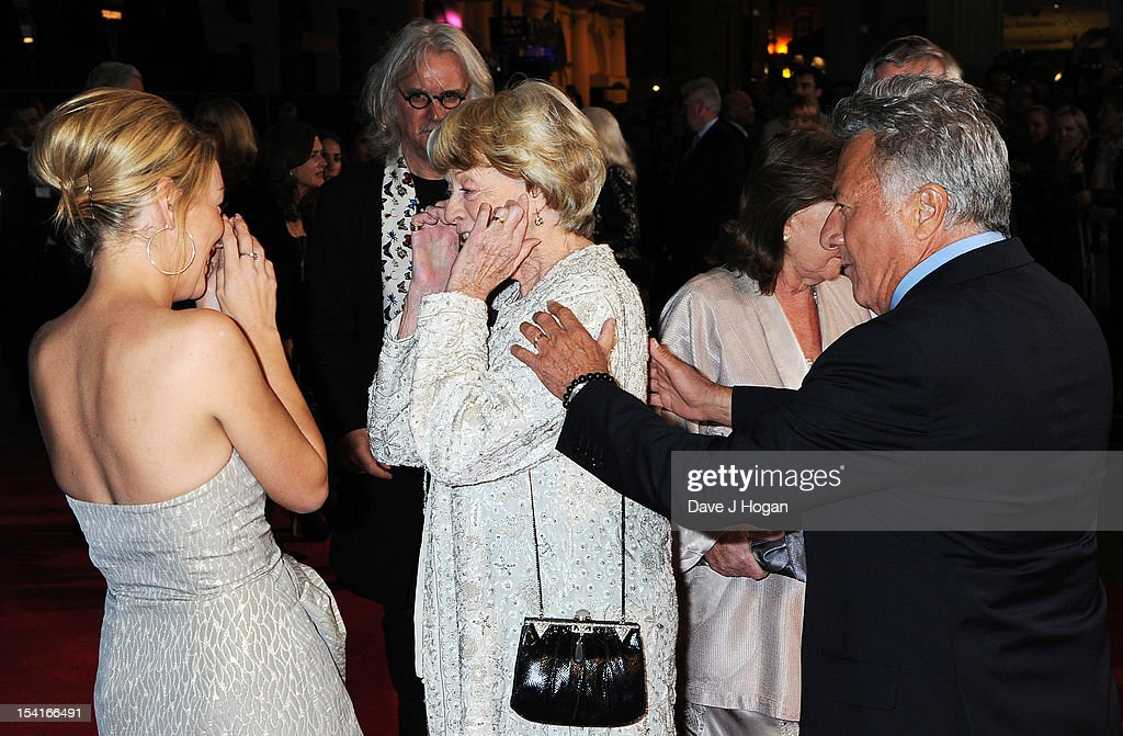 Actress Dame Maggie Smith puts her fingers in her ears as actress Sheridan Smith (L) and director Dustin Hoffman look on at the premiere of 'Quartet' during the 56th BFI London Film Festival at Odeon Leicester Square on October 15, 2012 in London, England.