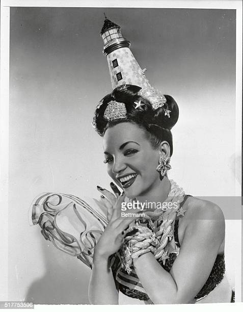 Actress dancer and singer Carmen Miranda who rose to fame in Hollywood and became known for her dizzy headgear earns enough to pay for those fabulous...