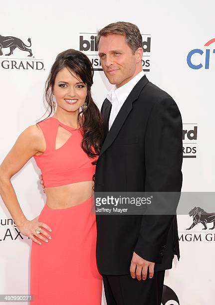 Actress Danica McKellar and guest arrive at the 2014 Billboard Music Awards at the MGM Grand Garden Arena on May 18 2014 in Las Vegas Nevada