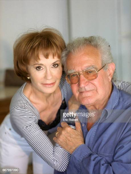 Actress Daniele Evenou sits with her husband former French minister Georges Fillioud