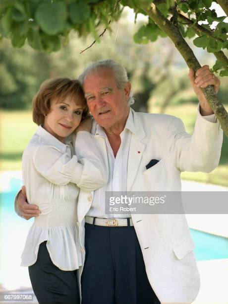 Actress Daniele Evenou stands with her husband former French minister Georges Fillioud