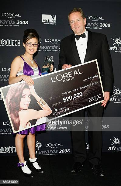 Actress Danielle Catanzariti poses with the L'Oreal Paris AFI Young Actor Award for 'Hey Hey It's Ester Blueburger' and her prize cheque for AUD20000...