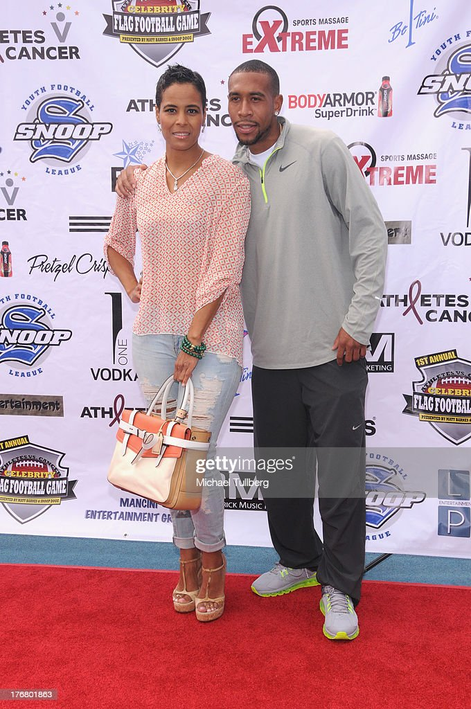 Actress Daphne Wayans and sprinter Bryshon Nellum attend the First Annual Celebrity Flag Football Game on August 18, 2013 in Pacific Palisades, California.
