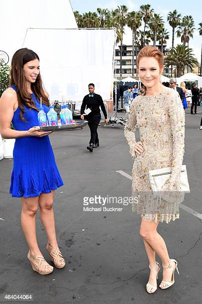 Actress Darby Stanchfield poses with FIJI Water during the 30th Annual Film Independent Spirit Awards at Santa Monica Beach on February 21 2015 in...
