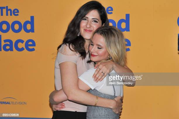Actress D'Arcy Carden hugs Kristen Bell during NBC's 'The Good Place' FYC at UCB Sunset Theater on June 12 2017 in Los Angeles California