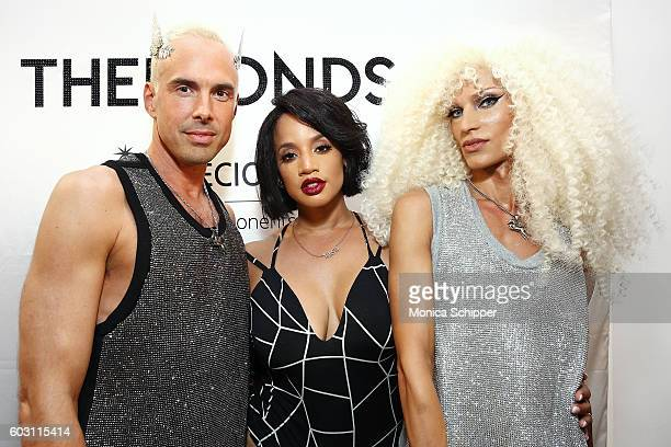 Actress Dascha Polanco poses for a photo with designers David Blond and Phillipe Blond backstage at The Blonds fashion show during MADE Fashion Week...