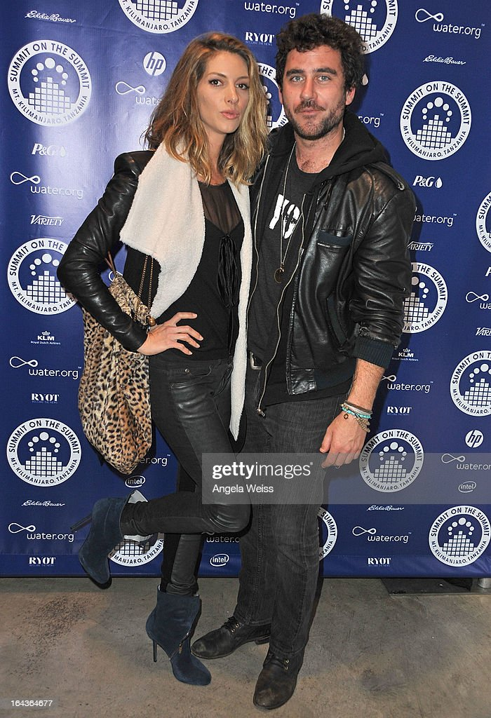 Actress <a gi-track='captionPersonalityLinkClicked' href=/galleries/search?phrase=Dawn+Olivieri&family=editorial&specificpeople=2516888 ng-click='$event.stopPropagation()'>Dawn Olivieri</a> and editor Bryn Mooser arrive at the Summit On The Summit photo exhibition celebrating World Water Day at Siren Studios on March 22, 2013 in Hollywood, California.