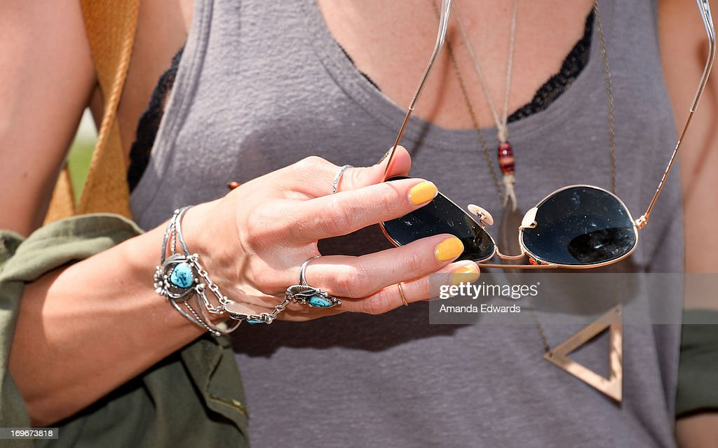 Actress Dawn Olivieri (jewelry and sunglasses detail) and The Environmental Media Association's Young Hollywood Board visit Helen Bernstein High School on May 30, 2013 in Hollywood, California.