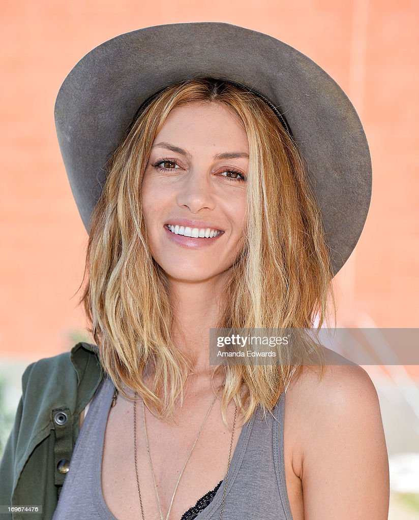 Actress Dawn Olivieri and The Environmental Media Association's Young Hollywood Board visit Helen Bernstein High School on May 30, 2013 in Hollywood, California.