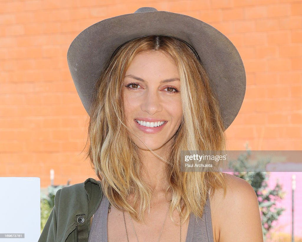 Actress Dawn Olivieri visits Helen Bernstein High School for the Environmental Media Association at Helen Bernstein High School on May 30, 2013 in Hollywood, California.