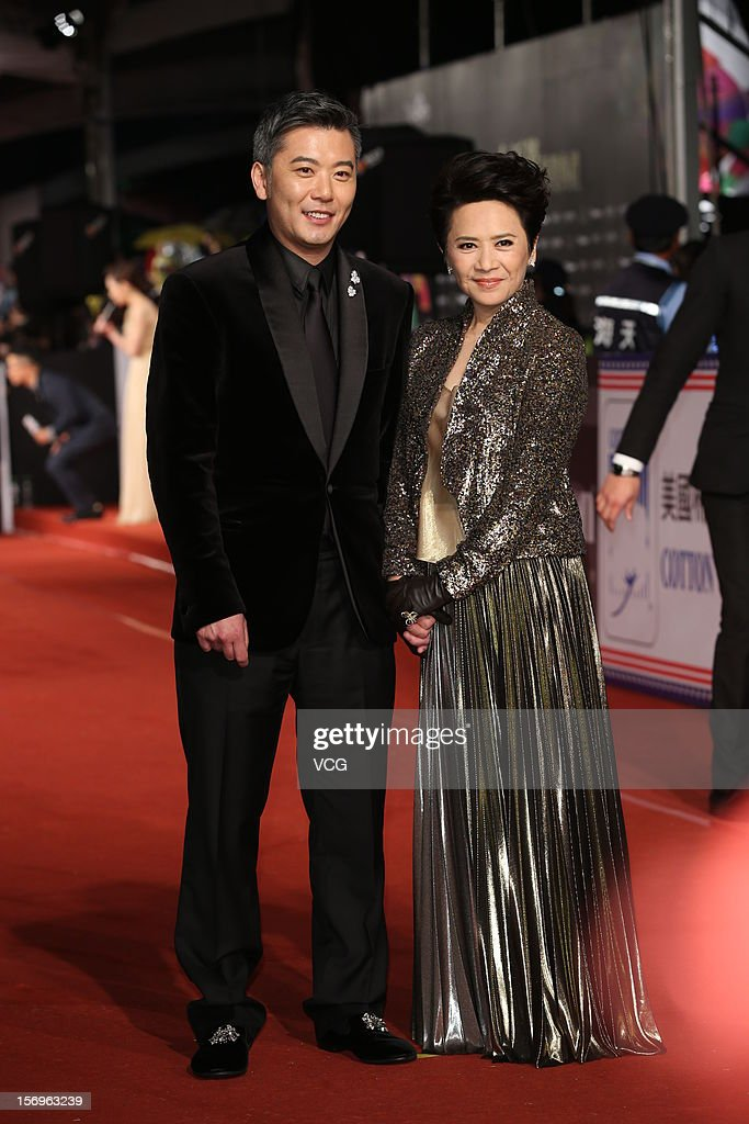 Actress Deannie Yip and her son Peter Cheung arrive at the red carpet of the 49th Golden Horse Awards at the Luodong Cultural Working House on November 24, 2012 in Ilan, Taiwan.