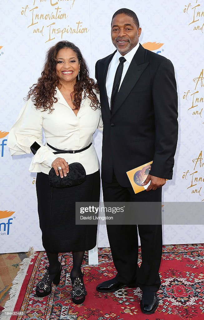 Actress <a gi-track='captionPersonalityLinkClicked' href=/galleries/search?phrase=Debbie+Allen&family=editorial&specificpeople=210660 ng-click='$event.stopPropagation()'>Debbie Allen</a> (L) and husband former NBA player <a gi-track='captionPersonalityLinkClicked' href=/galleries/search?phrase=Norm+Nixon&family=editorial&specificpeople=538782 ng-click='$event.stopPropagation()'>Norm Nixon</a> attend the 10th Annual Alfred Mann Foundation Gala in the Robinsons-May Lot on October 13, 2013 in Beverly Hills, California.