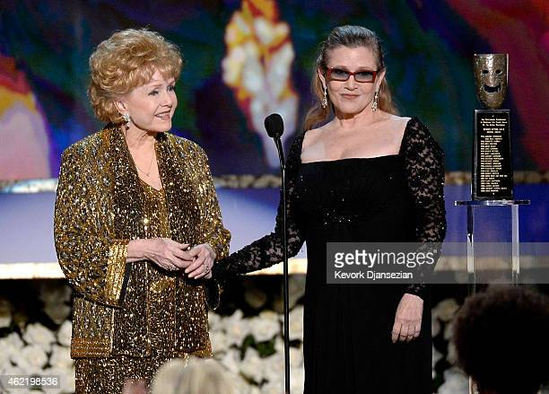 Actress Debbie Reynolds accepts the Life Achievement Award from actress Carrie Fisher onstage at the 21st Annual Screen Actors Guild Awards at The...