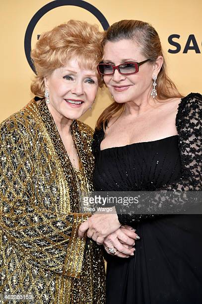 Actress Debbie Reynolds and actress Carrie Fisher pose in the press room at TNT's 21st Annual Screen Actors Guild Awards at The Shrine Auditorium on...