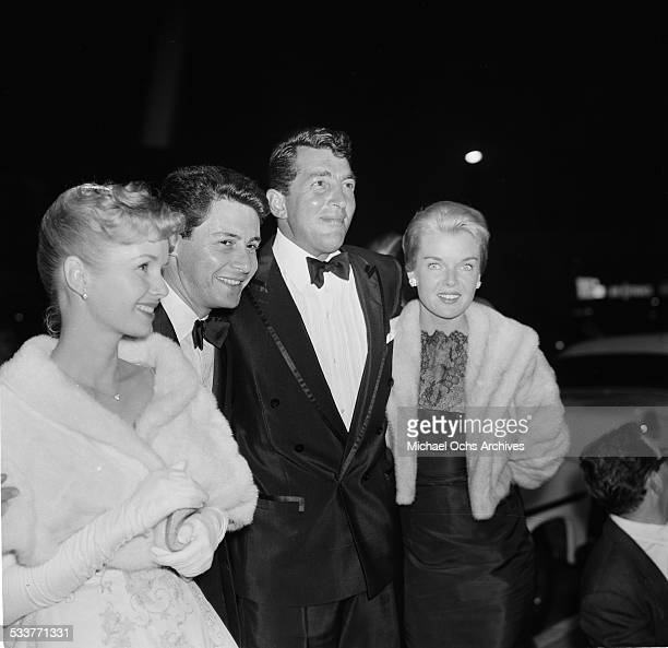 Actress Debbie Reynolds and Eddie Fisher poses with Dean Martin and his wife Jeanne Biegger attend the premiere of 'Rain Tree' in Los AngelesCA