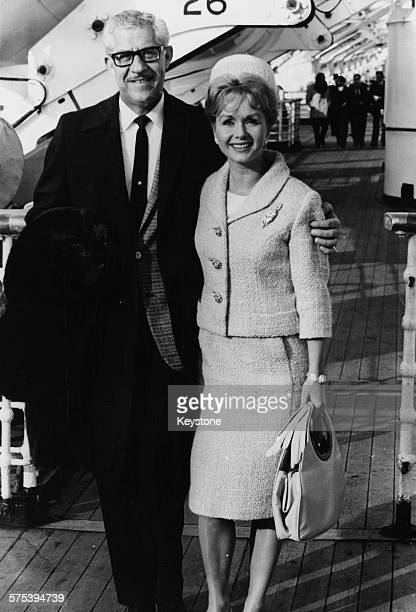 Actress Debbie Reynolds and her husband Harry Karl pictured aboard the Queen Elizabeth liner as they arrive at Southampton October 13th 1964