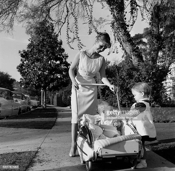 Actress Debbie Reynolds takes a walk with her children Carrie Fisher and Todd Fisher at home in Los AngelesCA