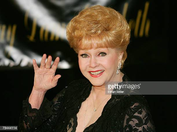 Actress Debbie Reynolds waves as she arrives for Dame Elizabeth Taylor's 75th birthday party at the RitzCarlton Lake Las Vegas on February 27 2007 in...