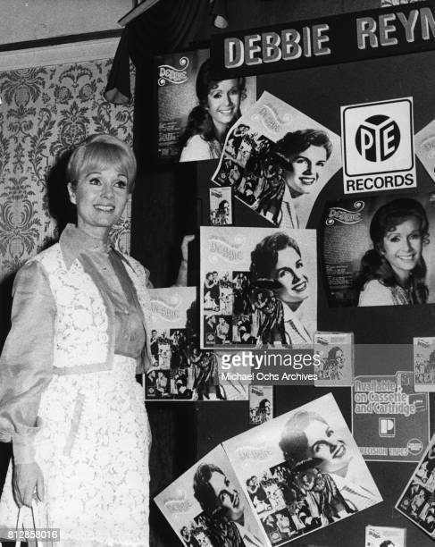 Actress Debbie Reynolds with a British display of her 1974 album release on PYE Label in the United Kingdom