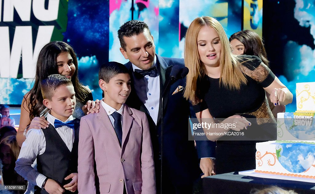 Actress Debbie Ryan (R) presents Buddy Valastro with the award for Favorite Cooking Show Award for 'Cake Boss' onstage during Nickelodeon's 2016 Kids' Choice Awards at The Forum on March 12, 2016 in Inglewood, California.
