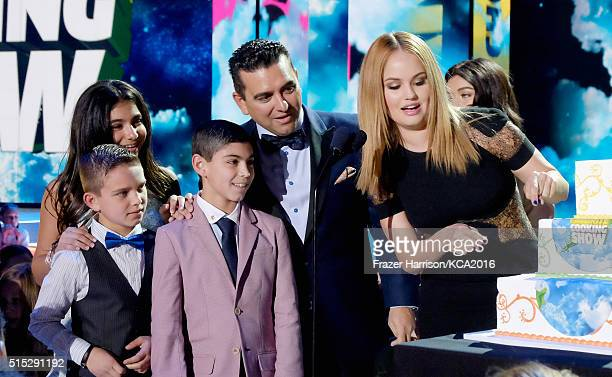 Actress Debbie Ryan presents Buddy Valastro with the award for Favorite Cooking Show Award for 'Cake Boss' onstage during Nickelodeon's 2016 Kids'...