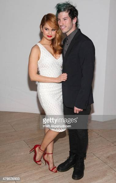 Actress Debby Ryan and her boyfriend musician Josh Dun attend the 2nd Annual Norma Jean Gala at The Paley Center for Media on March 18 2014 in...