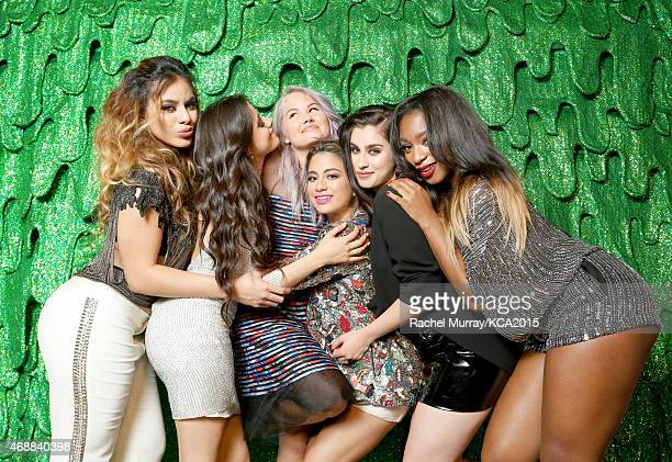 Actress Debby Ryan and singers DinahJane Hansen Camila Cabello Ally Brooke Lauren Jauregui and Normani Kordei of Fifth Harmony pose backstage at...