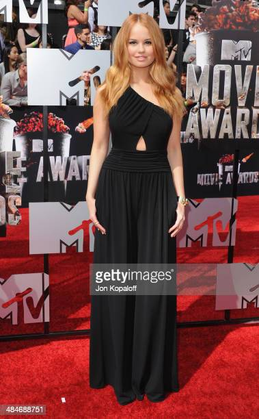 Actress Debby Ryan arrives at the 2014 MTV Movie Awards at Nokia Theatre LA Live on April 13 2014 in Los Angeles California