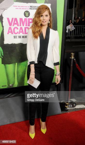 Actress Debby Ryan arrives at the Los Angeles premiere of 'Vampire Academy' at Regal Cinemas LA Live on February 4 2014 in Los Angeles California